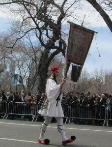Evzones wannabe carrying banner