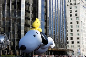 Snoopy carries Woodstock for a ride