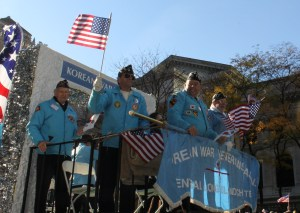 Korean Vets waving to the crowd